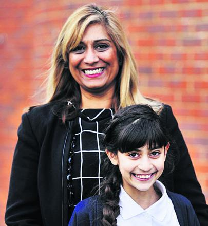 DELIGHTED: Pam Cameron and her daughter Chauni, 11, who got into first choice second