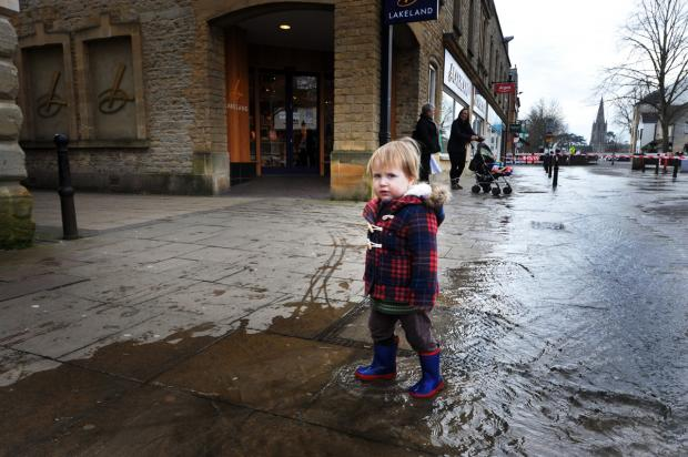 FLOODING: Hamish Wackett in the water outside Robert Dyas, Market Square, Witney