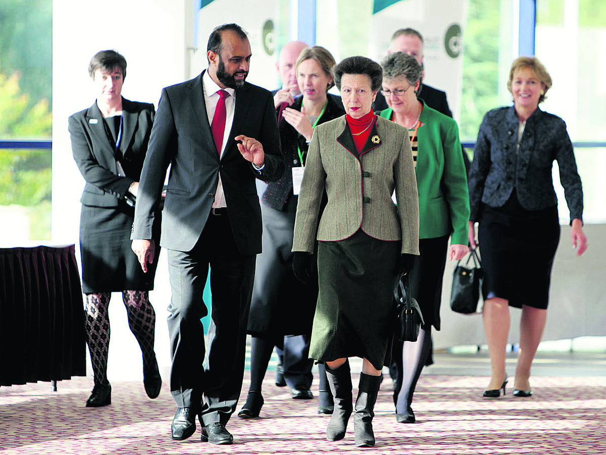 Victim Support chief executive Javed Khan leads the Princess Royal into the conference at Oxford's Kassam Stadium in 2012; below, volunteer Sheila Spencer