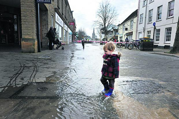 Hamish Wackett enjoys the water from the burst pipe. Picture: OX65755 Denis Kennedy