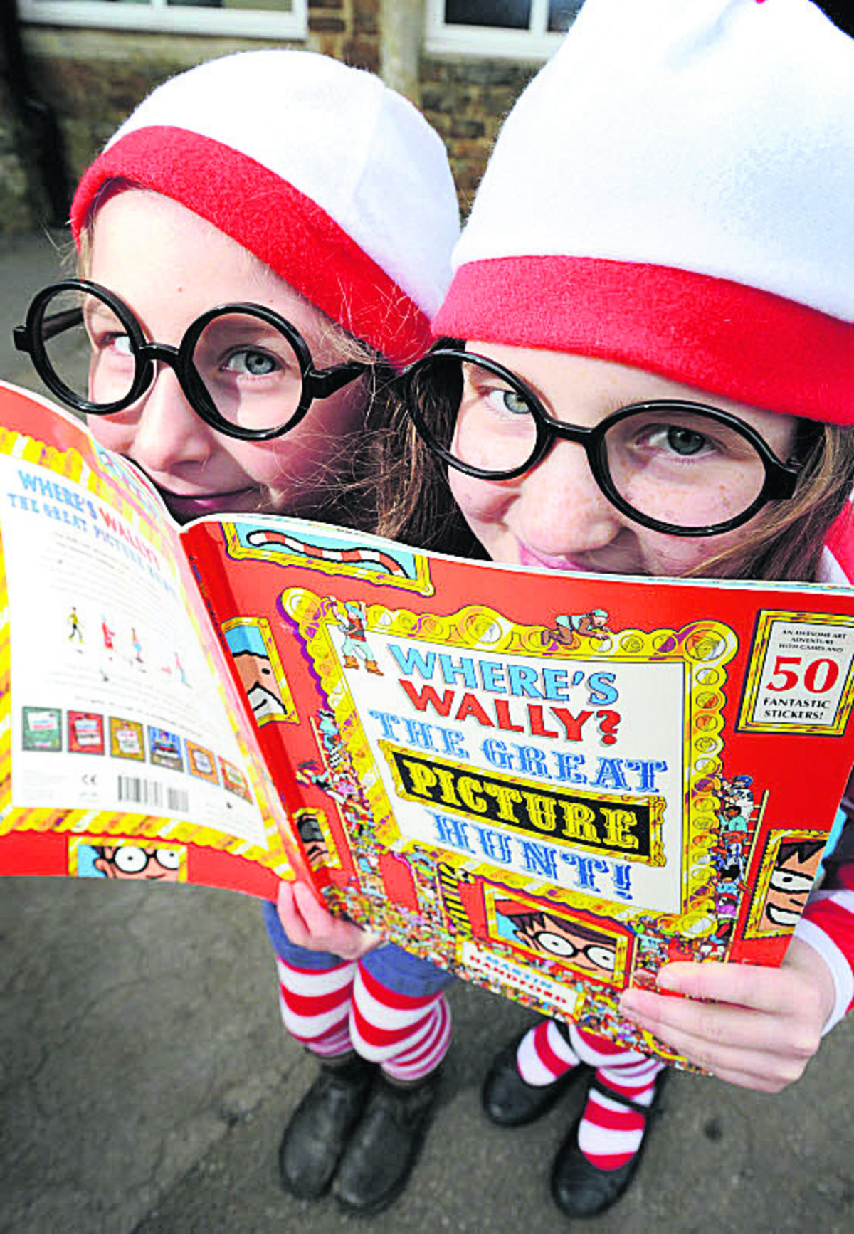 POLLY Rumsby, six, and Amy Covell, 10, dressed up as Wally from the Where's Wally? Pictures: OX65749 Jon Lewis, OX65744 Simon Williams