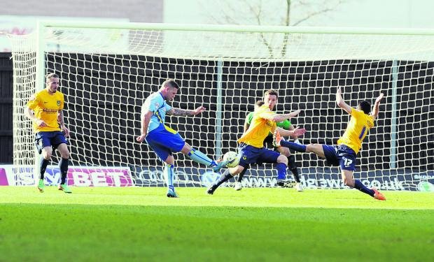 Johnny Mullins and Danny Rose (No 17) do their best to try and block Billy Kee's goalbound shot