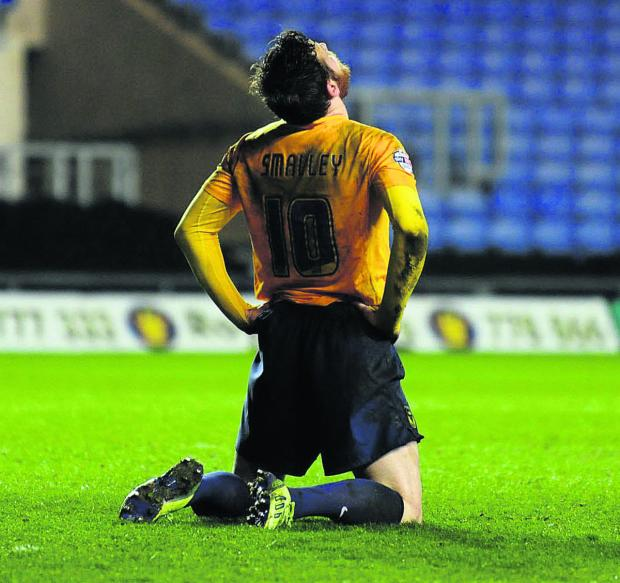 Witney Gazette: Deane Smalley cannot believe it as a golden opportunity goes begging in the first half