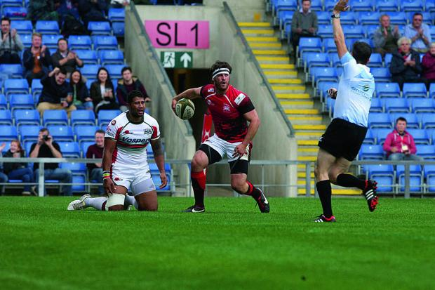 London Welsh's Mike Denbee scores against Plymouth Albion at the Kassam Stadium in November.