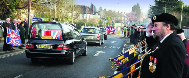Witney Gazette: Mourners pay their respects to Sapper Adam Moralee at Headley Way as the cortege approaches the John Radcliffe Hospital.