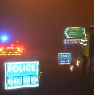 Witney Gazette: Police man a road block in Gillingham, near Beccles, Norfolk, as emergency services are attending a helicopter crash in Norfolk, police said.