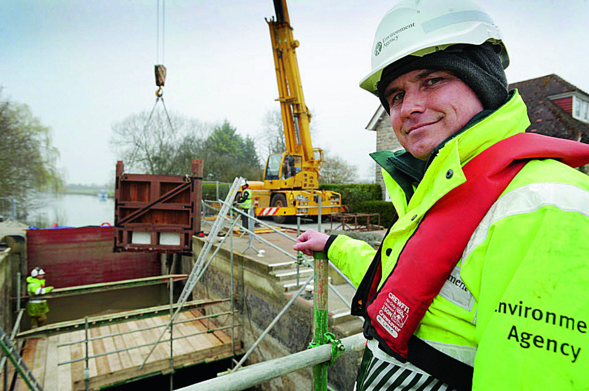 The Environment Agency is replacing the lock gates at Grafton Lock on the Thames. Operations team leader Al Wells oversees one of the head gates being lowered into position