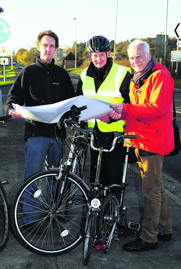 Witney Gazette: Bike Safe chairman Ian Leggett looks at plans for the cycle path with John Griffin and Graham Smith                           Pictures: OX63950 David Fleming
