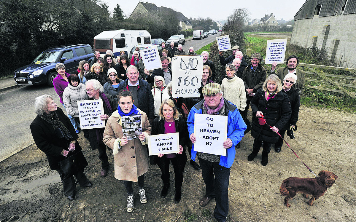 Residents protest as West Oxfordshire councillors visit the site of the proposed 160 Bampton homes development