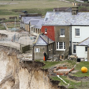 A resident of the cottage on the cliff edge at Birling Gap near Eastbourne
