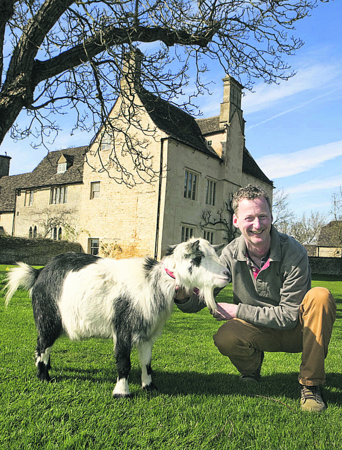 Cogges Manor Farm Museum director Colin Shone and Jonathan the goat ready to welcome visitors