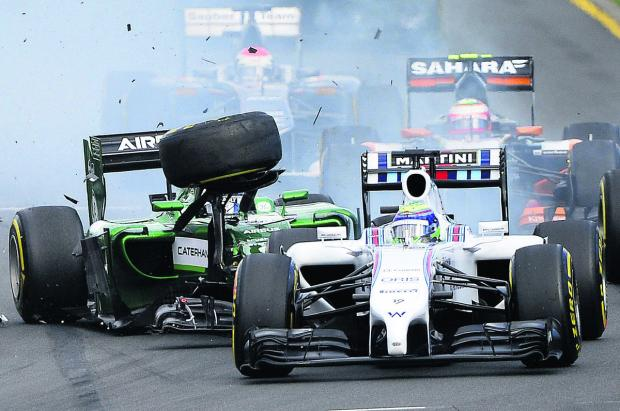 Kamui Kobayashi's Caterham (left) collides with the rear of Felipe Massa's Williams at the start of Sunday's Australian Grand Prix