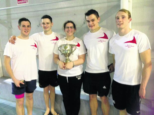 Witney swimmers pictured after their success at Aylesbury. Pictured (from left): Sam Bark, Callum McLean, Chantal Clavaud (coach), James Bark and Tom McLean