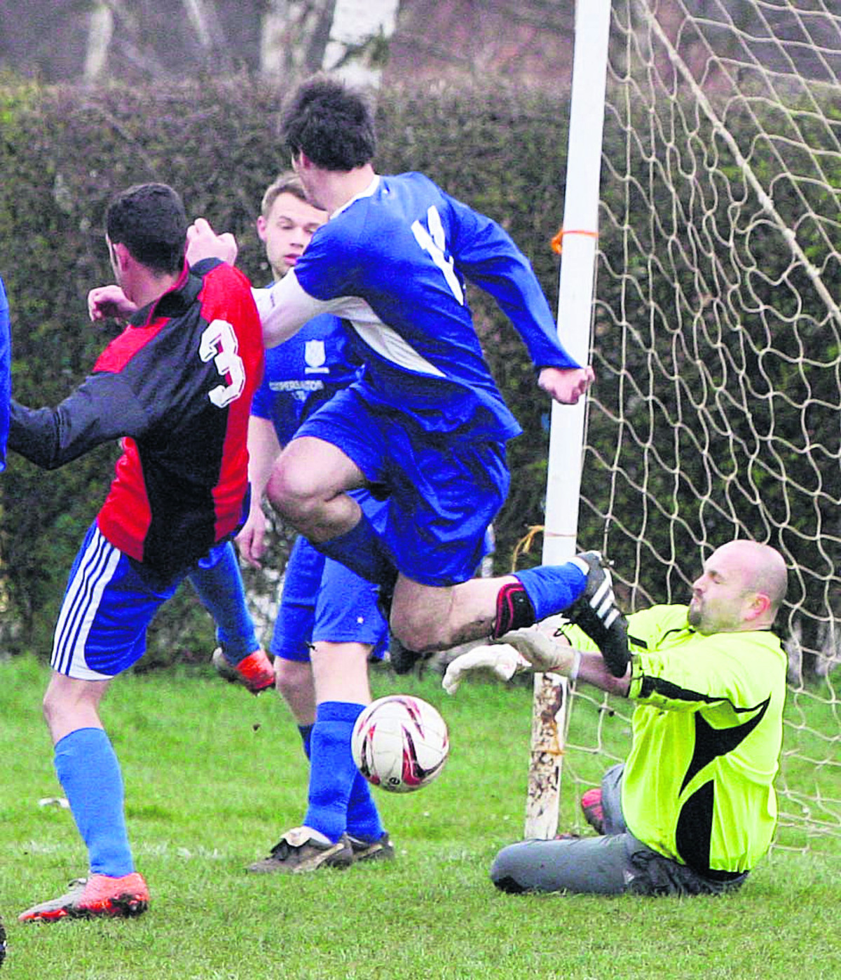 Woodstock Wanderers' keeper James Franklin makes a brave save in their 4-3 defeat at Northway Res in Division 2 on Sunday