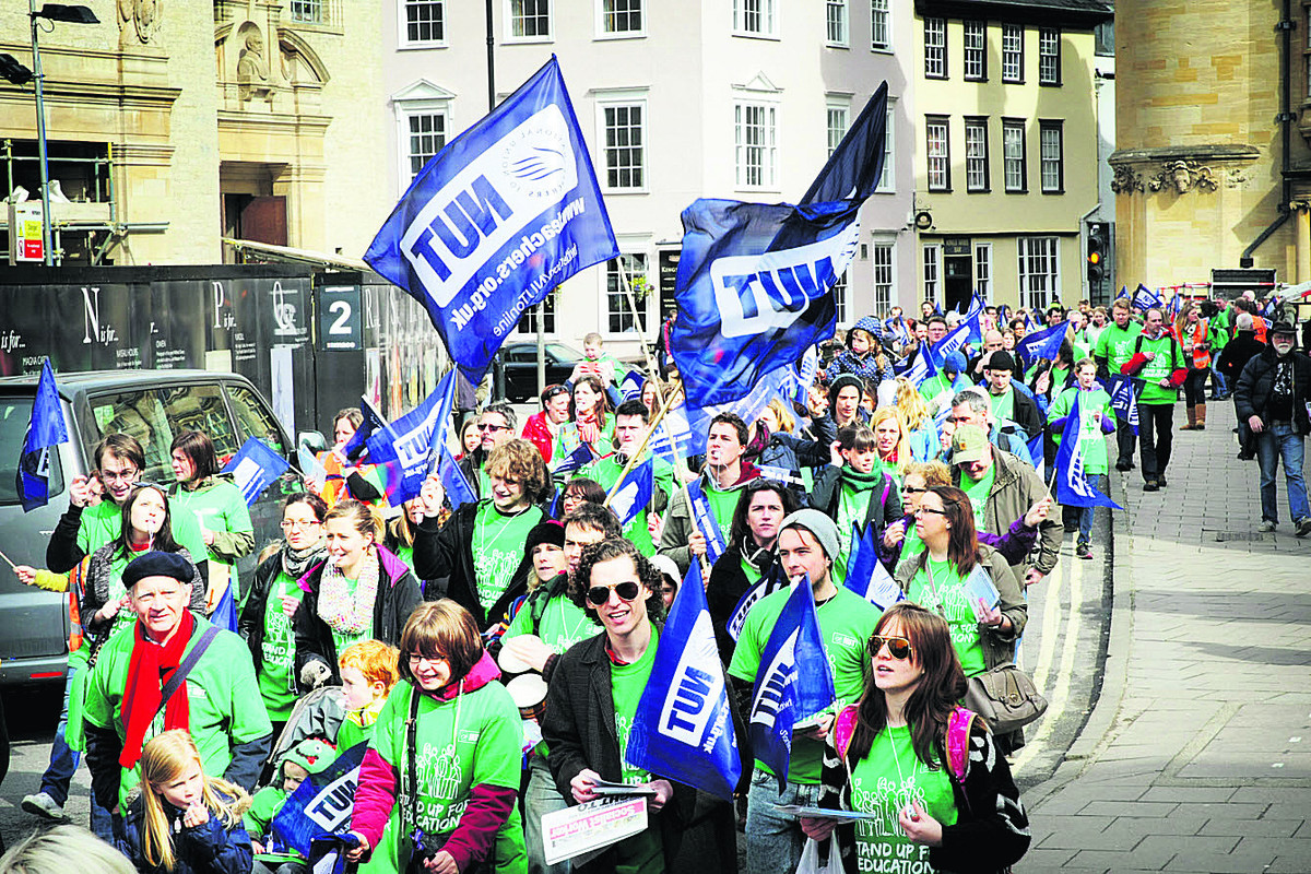Striking teachers and supporters march along Broad Street, Oxford. Picture: OX6