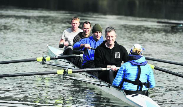 From left, coach Allan French explains the art of rowing to three of the firefighters' crew – Darren Taylor, Simon Tyrrell and Spike Miles on the Thames in Oxford. Picture: OX66221 Mark Hemsworth