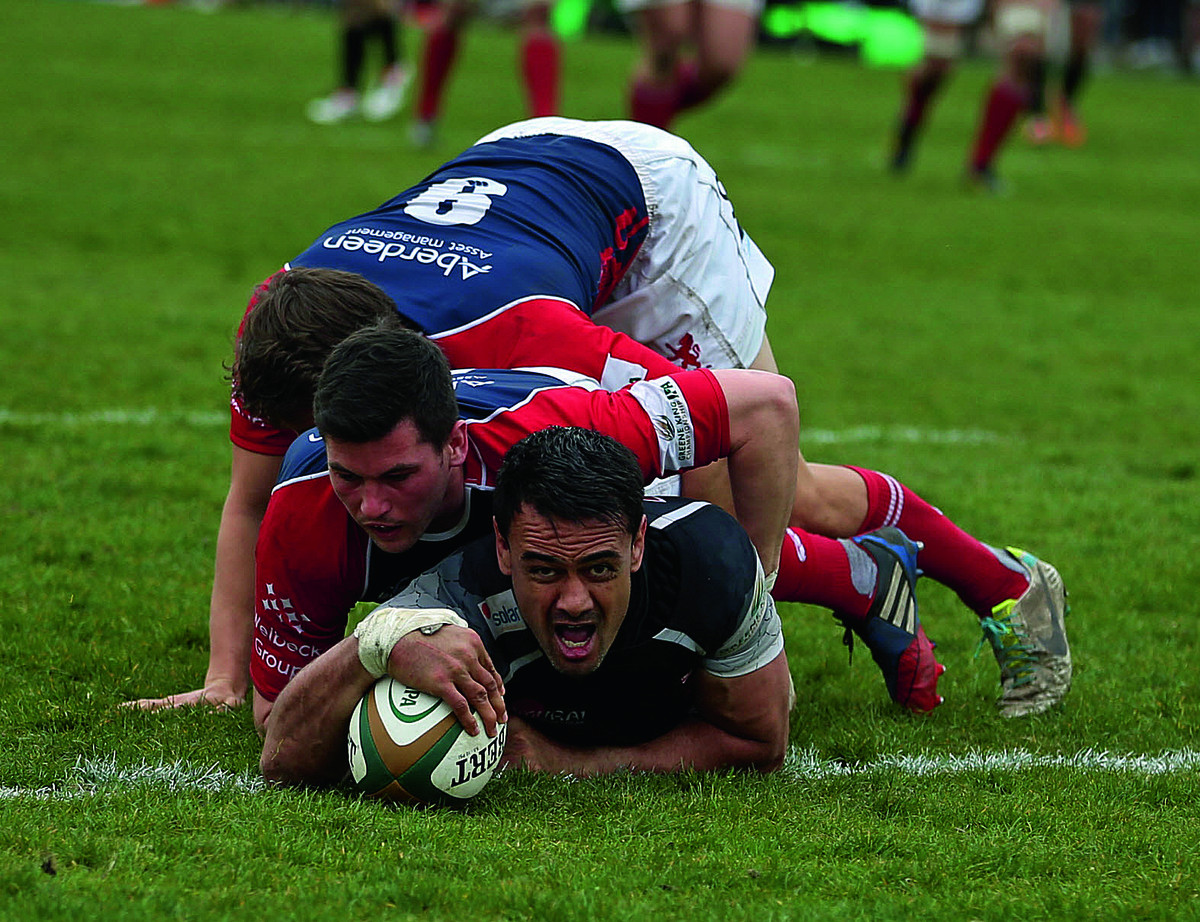 Dan Browne shouts with delight after scoring London Welsh's first try
