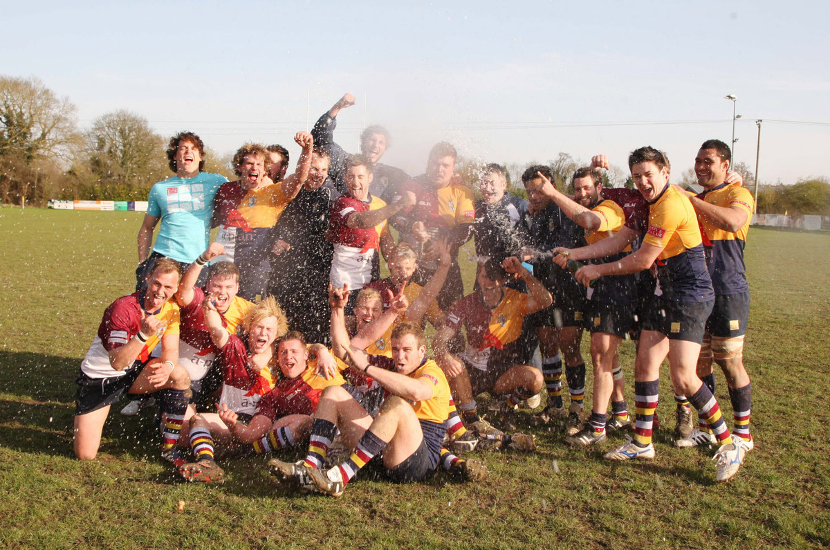 Oxford Harlequins crack open the champagne to celebrate winning the South West 1 East title