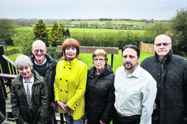 Witney Gazette: Residents, left to right, Anne and David Wilson, Jacki Dickenson, Trudi Lee, Cllr Andrew Coles and Colin Dickenson say plans to build 270 homes in Windrush Valley will spoil some of the best views in Witney
