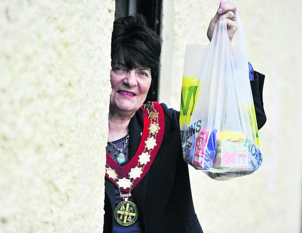 HELP: Carterton mayor Lynn Little with the first public donation of food to the food bank
