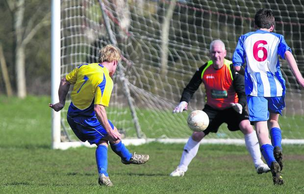 Ducklington's Jack Morton has a pot at goal during their 3-1 home win against Chadlington which boosted their Premier Division title chances, while (below) Chadlington's Richard Ingram is in control