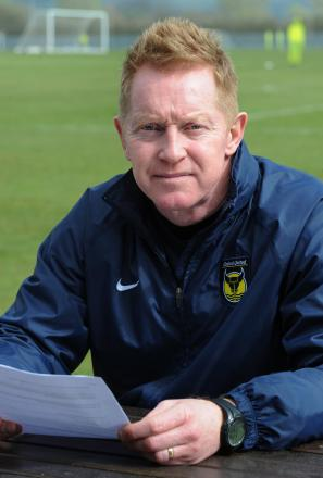 Gary Waddock reads through questions from United fans