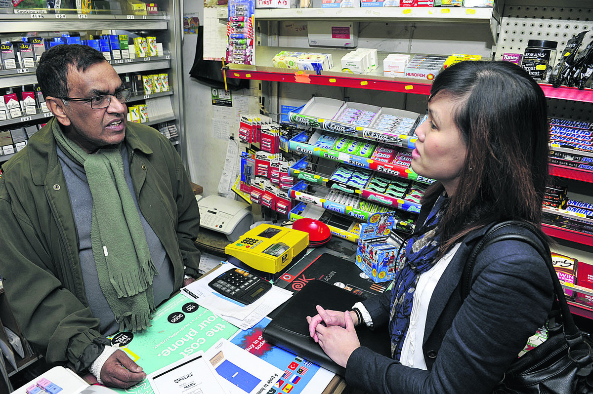 Shopkeeper Vijaya Karunaratne talks to crime prevention and reduction adviser Julie Young. Pictures: OX66198 Mark Hemsworth