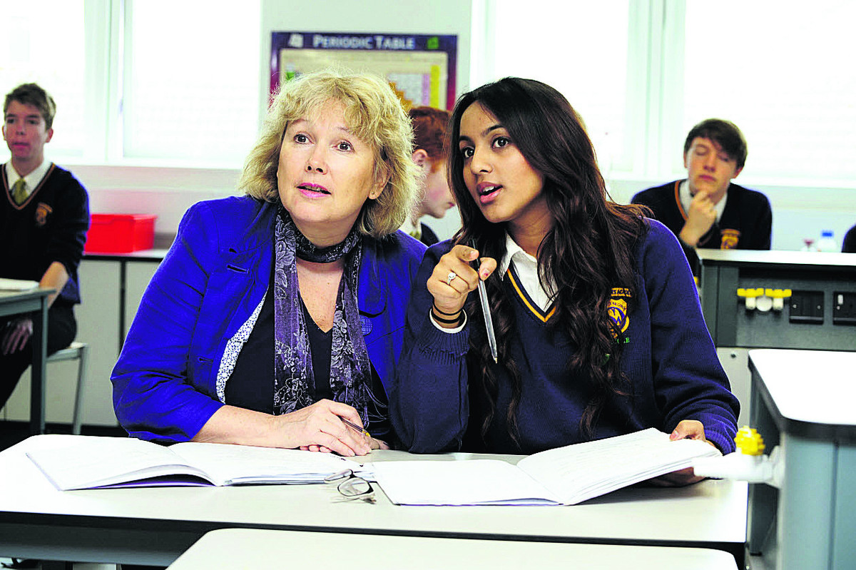 Sue Croft with Zainab Azam, 16, in a science lesson in the new block