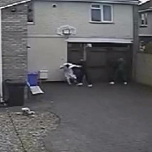 The moment a woman confronted two suspected burglars in her dressing gown before being subjected to an horrific attack at her home in Kettering, Northamptonshire.