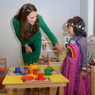 Witney Gazette: The Duchess of Cambridge meets Bailey Taylor, six, during her visit to the Rainbow Place Children's Hospice in Hamilton, New Zealand