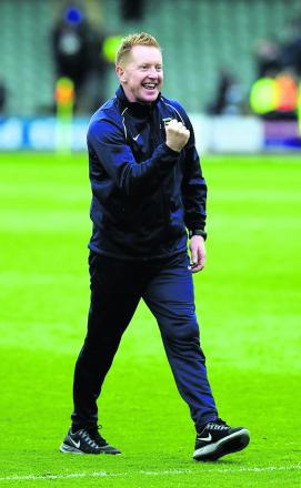 Oxford United boss Gary Waddock celebrates with the travelling fans after his side won 2-0 at Plymouth on Saturday