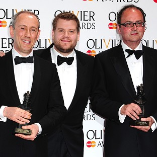 Sir Nicholas Hytner (left) and Nick Starr (right) win the Special Award, presented by James Corden (centre) at the Royal Opera House in Covent Garden, London.