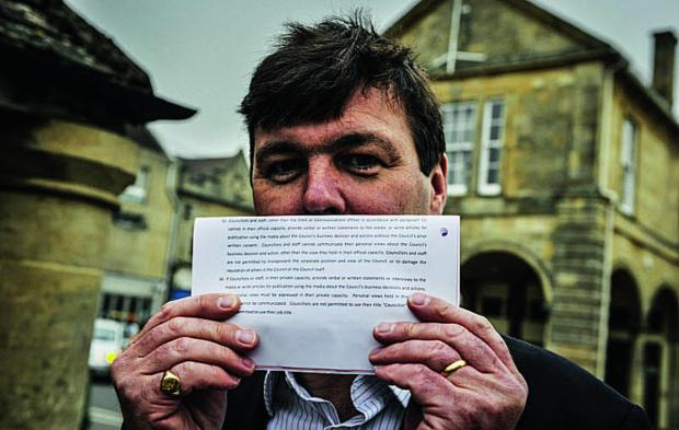 Cllr Duncan Enright with the clause from the document proposing to ban Witney town councillors from talking to the press