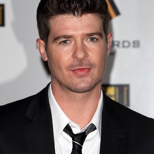 Robin Thicke's song Blurred Lines has been named the UK's most downloaded track of all time