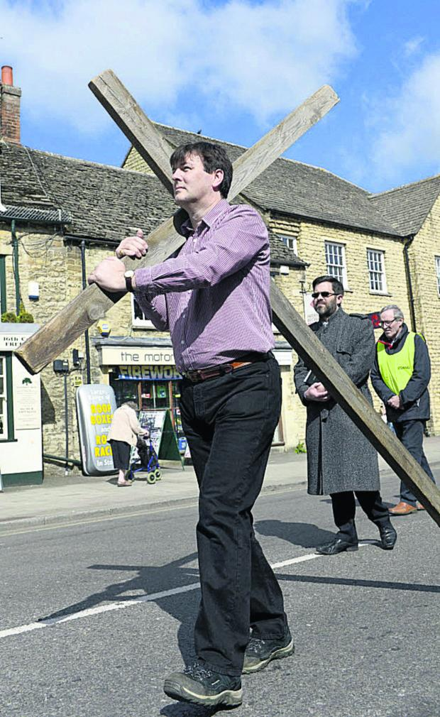 Witney Gazette: Duncan Enright leads the Walk of Witness along Witney High Street