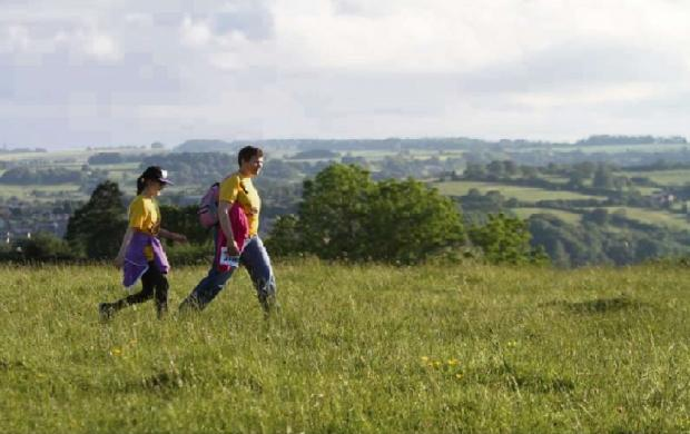 Walkers in the Cotswold hills