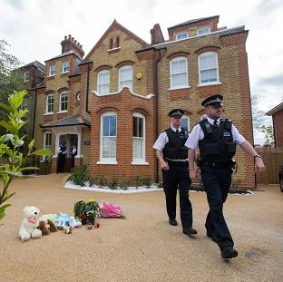 Witney Gazette: Police at a house in New Malden, south London, after a woman was arrested following the discovery of three dead children