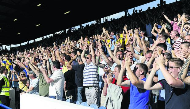 Oxford United supporters celebrate at Portsmouth this season
