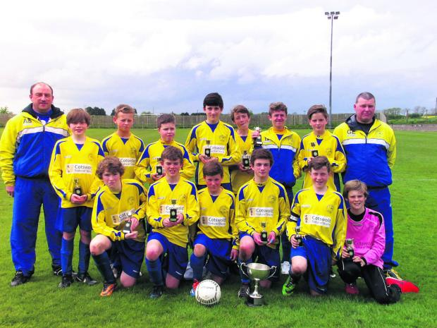 Ducklington celebrate their treble win