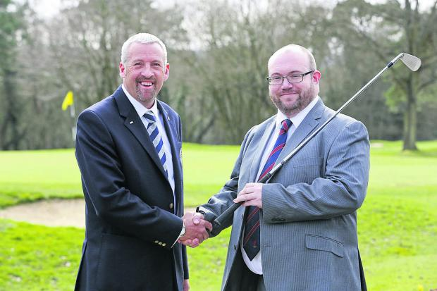 Richard Talboys (right) is congratulated on his award by PGA South Region chairman Rob Edwards