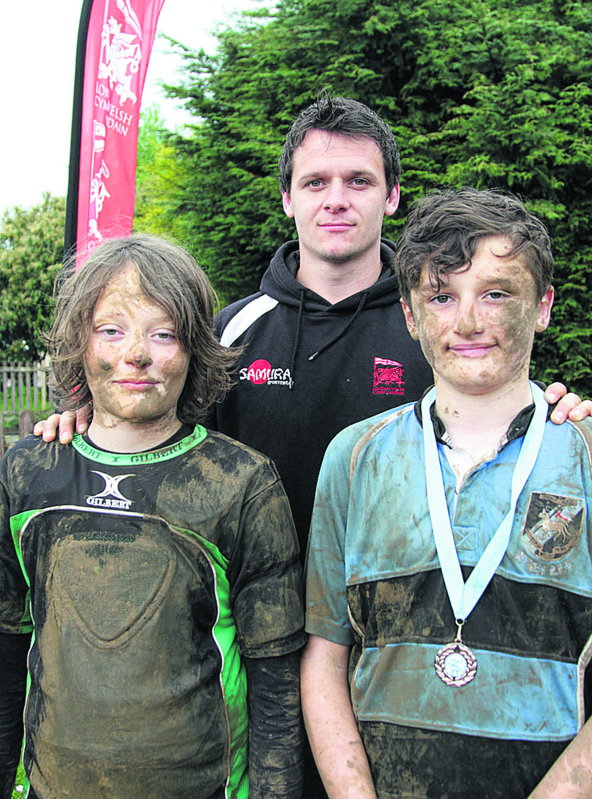 Ben Williamson (left) and Ben Edwards, from Witney RFC, pictured with London Welsh's Rod Lewis at the Oxfordshire mini & midi rugby festival