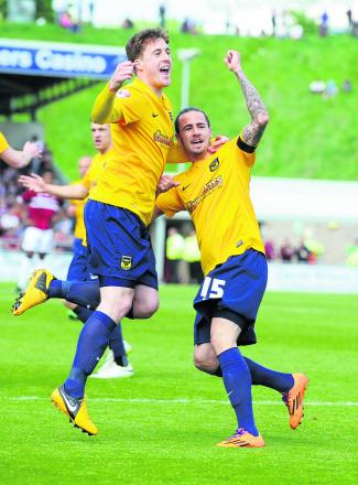 Scott Davies celebrates Ryan Williams's early goal for Oxford, before things went bad for the winger, who was sh