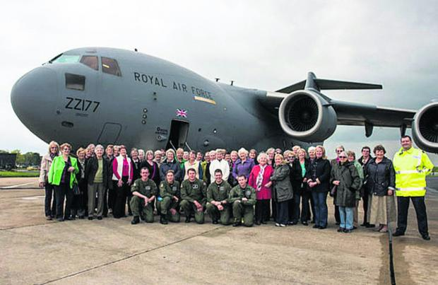West Witney WI members pictured in front of one of 99 Squadron's C17s with some of the crew.