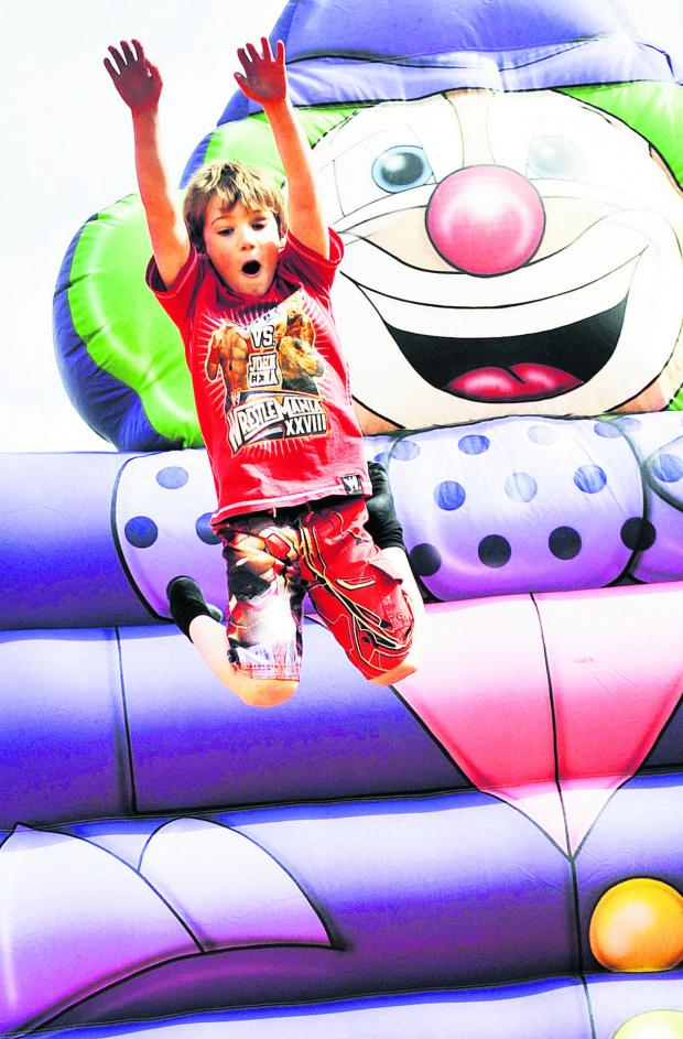 Witney Gazette: Mason Morgan, six, has fun on the bouncy castle. Pictures: OX66845 Mark Hemsworth