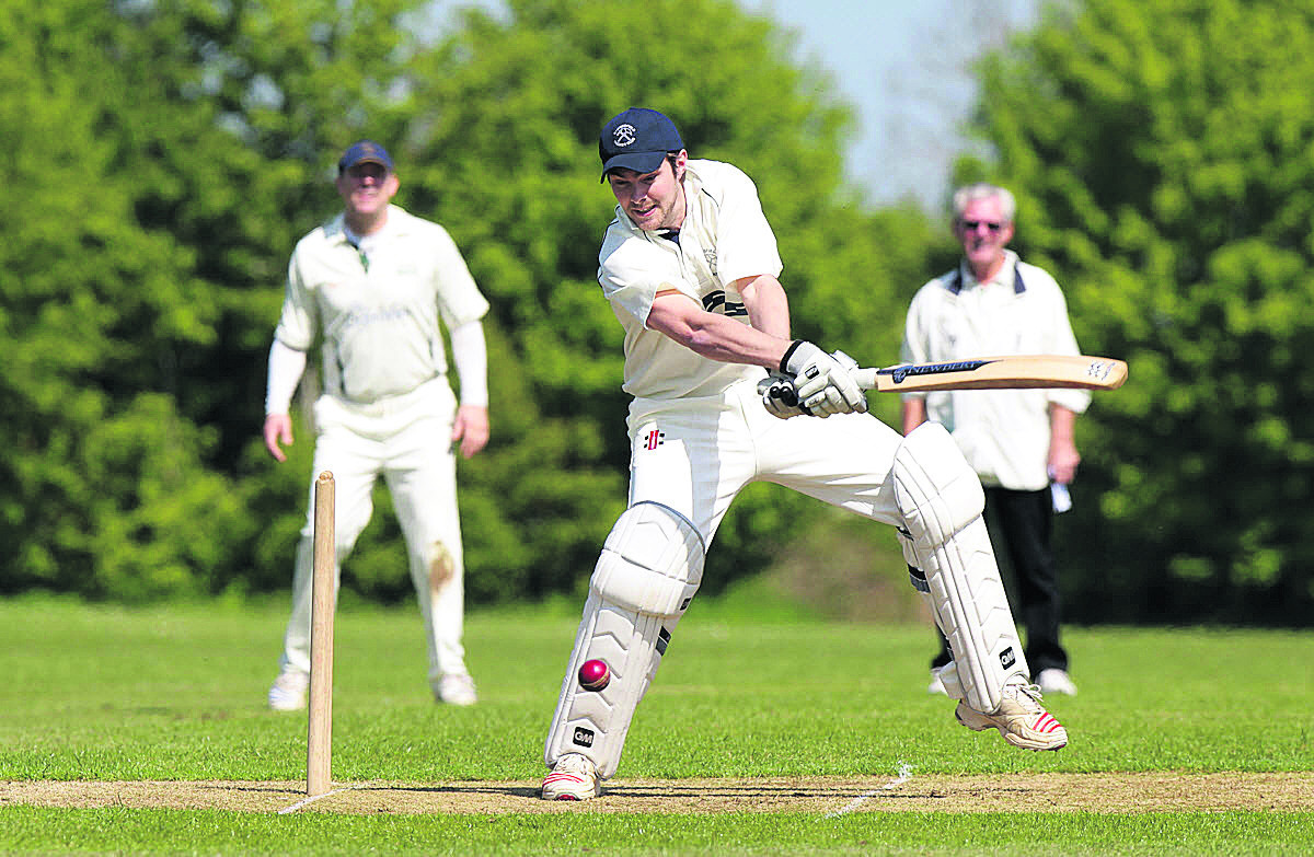 Stonesfield skipper Tim Wyatt plays a shot through the off side on his way to 48 in their 112-run win against Watlington, while (below) Jamie Burns makes his ground