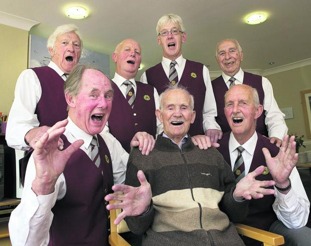 Witney Gazette: David 'Haydn' Cooper, front centre, joins current members of the Oxford Welsh Male Voice Choir – back from left, Ron Salter, Derek Straughair, George Jenkinson and Vic Merry, and, front, Philip Bunce, left, and Malcolm Hookham in a singalong at the