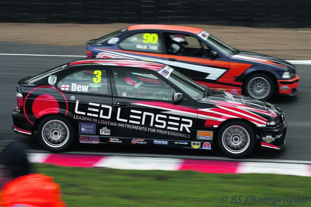 Alex Dew (No 3) fights it out with Nick Hill (90) at Brands Hatch