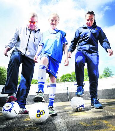 ON THE BALL: Smooga director Keith Place, left, with Tower Hill Primary School pupil Kasey Griffin and Oxford United Women's first team striker Natasha Caswell