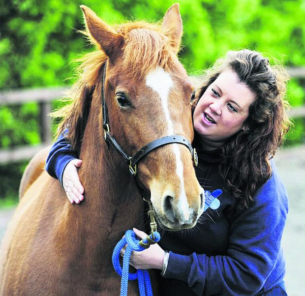 Jenna Martyn with one of her charges at the Blue Cross rehoming centre in Burford
