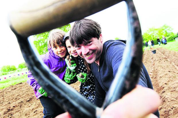 Alex James with Zoe Lamb, nine, pictured left with Emily Jones, six. Picture: OX67